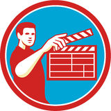 Film Crew Clapperboard Circle Retro. Illustration of a film crew with clapperboard filming viewed from front set inside circle on  background done in retro style Stock Photography