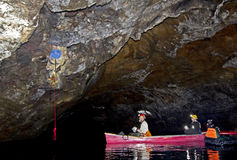 Film Crew Working inside Lava Tube Lake Cave Stock Photography