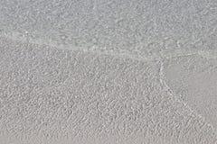 Film des transparenten karibischen Wassers ?ber wei?em Sand lizenzfreie stockfotos