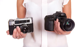 Film or Digital. Film or Digital camera. Two cameras to choose from in female hands on a white background Royalty Free Stock Photos