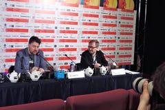 Film director Albert Serra and cinema expert Pyotr Shepotinnik. MOSCOW - JUNE 29, 2017: Film director Albert Serra from Catalonia, Spain at press-conference of royalty free stock photos