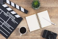 Film director desk with movie clapper board. Top view. Film director desk with movie clapper board. Top view royalty free stock photo