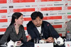 Film director Kim Bong-Han and translator woman. MOSCOW - JUNE 24, 2017: Film director Kim Bong-Han South Korea gives a press-conference at 39th Moscow Royalty Free Stock Photo