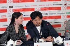 Film director Kim Bong-Han and translator woman royalty free stock photo