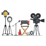Film director workplace. Film directors chair with megaphone, projector, camera and clapboard. Work on the set of the film. Flat vector cartoon illustration Stock Photo