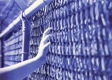 Film Distortion of a Hand on a Fence royalty free stock photos