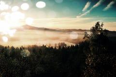 Film effect. Amazing  daybreak in Saxony Switzerland park. Sandstone peaks increased from foggy background Royalty Free Stock Photography