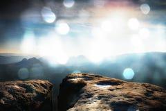 Film effect. Amazing  daybreak in Saxony Switzerland park. Sandstone peaks increased from foggy background Royalty Free Stock Images
