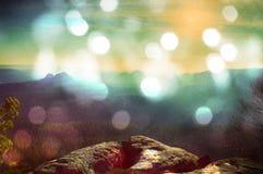 Film effect. Amazing  daybreak in Saxony Switzerland park. Sandstone peaks increased from foggy background Stock Photo