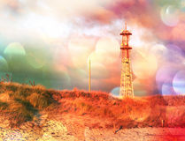 Film effect. Meteorological tower station, steel construction at sea offshore. Dunes with dry stalk of grass and reeds. Tower with Stock Images