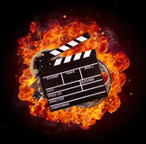 Film equipment in fire, isolated on black background vector illustration