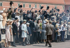 Film extras perform for a movie scene in Castle Square in the Old Town in Warsaw in Poland. Royalty Free Stock Images