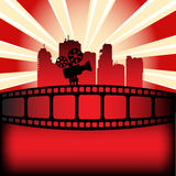 Film festival. Colorful background with black movie projector shape, film strip and skyscraper silhouettes Stock Images