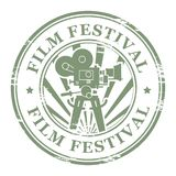 Film Festival. Abstract grunge stamp with movie camera and the word Film Festival Stock Photos