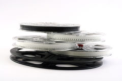 Film on film reels. Film reels with film. Cinema film on another cinema film royalty free stock photo