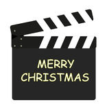 Film flap - Merry Christmas. In golden color Royalty Free Stock Photography