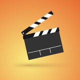 Film flap. On an orange background Stock Photos