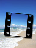 Film frame of a beautiful sandy beach. Film frame , sunshine, sand, and waves at the beautiful beach,  vacation concept Royalty Free Stock Photo