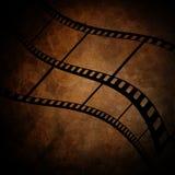 Film frame. On a grunge vintage background Stock Photos