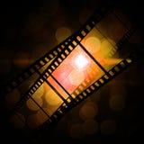 Film frame. On a grunge vintage background Stock Images