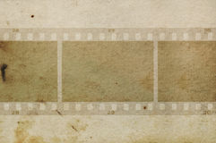 Film frames grungy paper. Blank film frames negative on grungy paper background texture. Design element stock photography