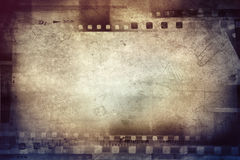 Film frames. Film negative frames on brown background Royalty Free Stock Photos