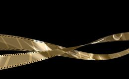Film Gold. 35 mm film negative gold black background Royalty Free Stock Images