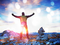 Film grain effect.  Happy hiker with raised arms in the wind.  Tourist guide at stocked pyramid Stock Photography