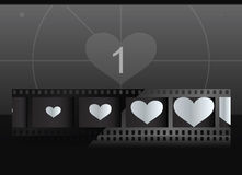 Film with heart in frames and screen on background Royalty Free Stock Photography