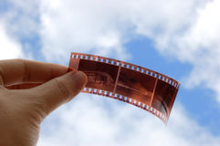 Film holding with hand Royalty Free Stock Photo
