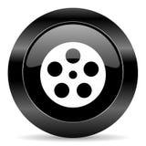 Film icon. Black circle web button on white background Stock Image