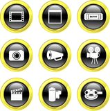 Film icons. Set of film related icons on black glossy buttons isolated on white Stock Photography