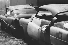 Film image black & white Buick lowrider. 2 Buick Straight 8 autos, black & white film image Stock Image