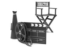 Film industry: directors chair. With film strip and movie clapper Stock Photography