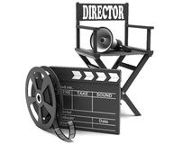 Film industry: directors chair. With film strip and movie clapper Royalty Free Stock Images