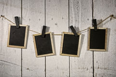 Film Looking Chalkboards Hanging on a Rope Held By Clothespins Stock Image