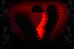 Film Love. A filmstrip of 35mm negative in the shape of heart - a metaphor of love Royalty Free Stock Image