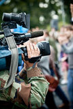 Film maker recording. News maker on reportage recording crowd Stock Photography