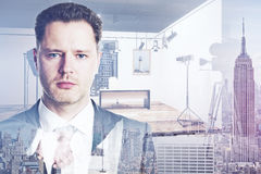 Film making concept. Portrait of attractive young businessman on abstract city and studio background. Film making concept. Double exposure Royalty Free Stock Images