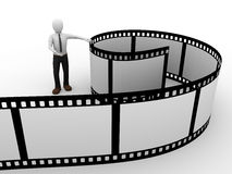 Film man. A man presenting a rolled film. Cinema Concept Royalty Free Stock Image