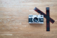 Film 35mm Camera lay on wooden table. A Film 35mm Camera lay on wooden table royalty free stock image