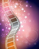Film Movie Background. A bright star filled film strip movie reel background with stars and bright lights Royalty Free Stock Images