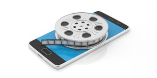 Film movie reel and a smartphone on a white background, isolated, 3d illustration. Stock Photos