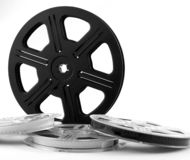 Film or movie reels. Four film reels with film strips. Isolated film or movie stock images