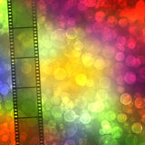 Film on the multicolored background with bokeh Royalty Free Stock Image