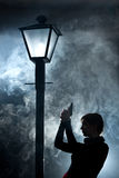 Film noir woman lamppost fog girl gun royalty free stock image