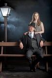 Film noir couple street lantern bench fog mist Royalty Free Stock Photos