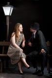 Film noir couple street lantern bench Stock Photo