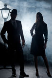 Film noir couple street lantern mist royalty free stock photography