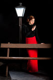 Film noir girl street lantern bench stock photography